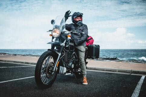 Daniel 'Beardy' McLaughlin on a Royal Enfield Himalayan at Bondi Beach