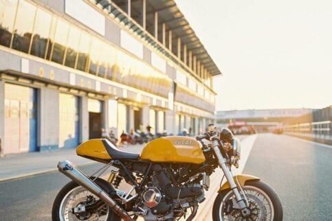 Ducati Sport Classic motorcycle at a race track at sunset