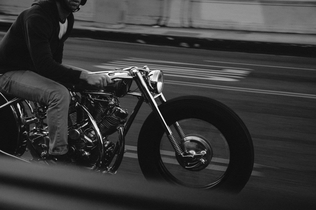 Max Hazan rides one of his custom motorcycles on an LA freeway