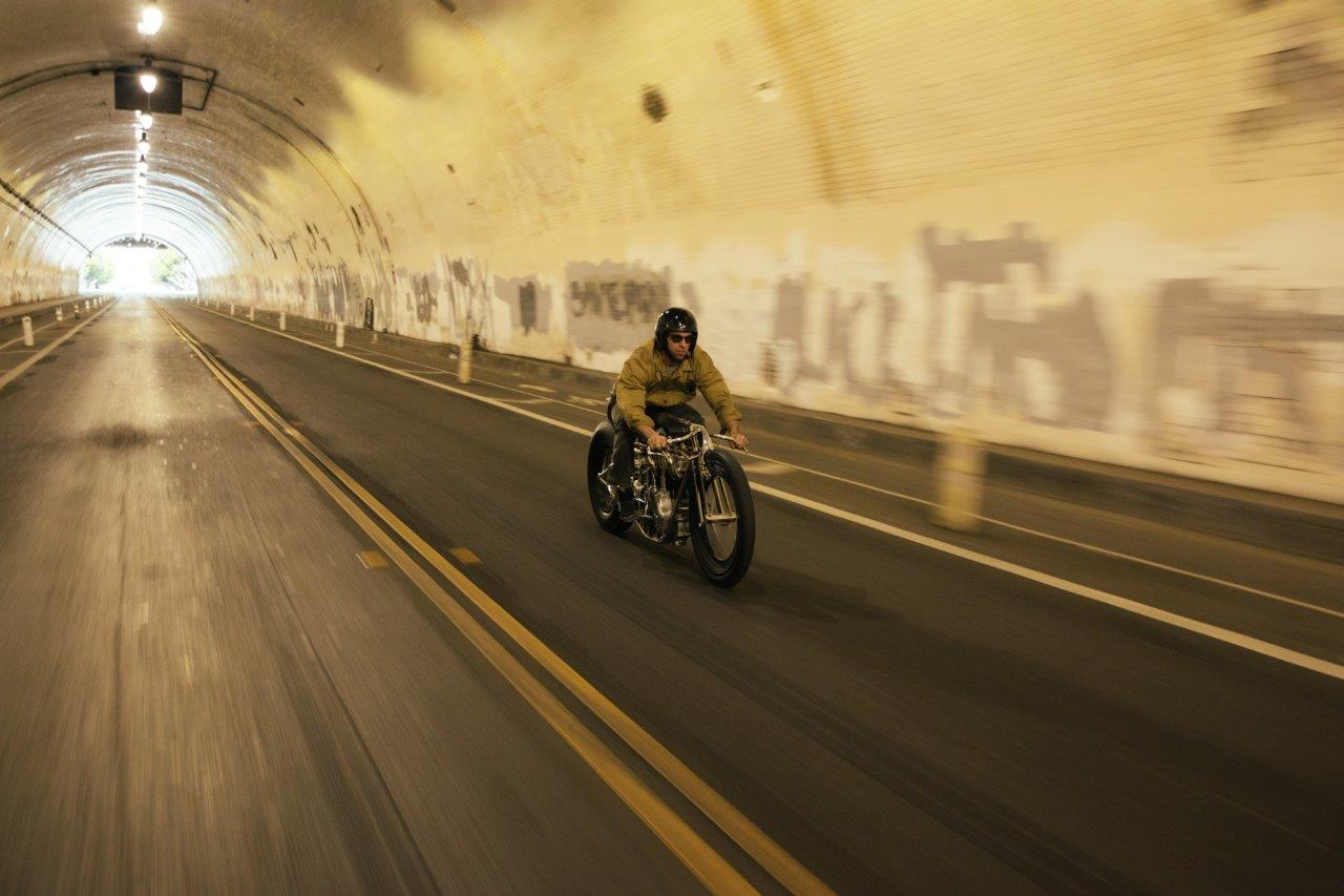 Max HAzan rides one of his custom motorcycles in a Los Angeles tunnel