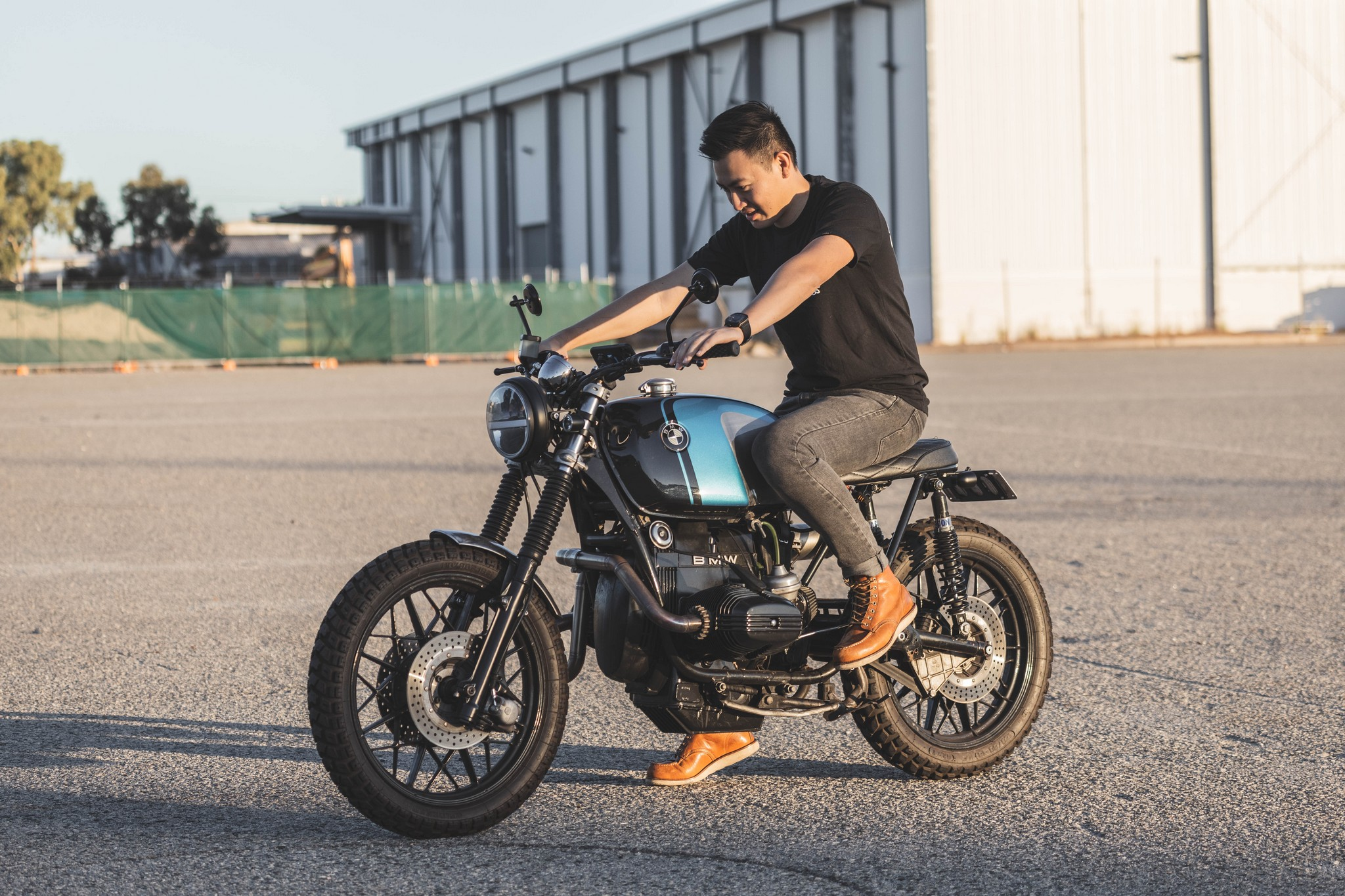 BMW Street Scrambler with man and shed