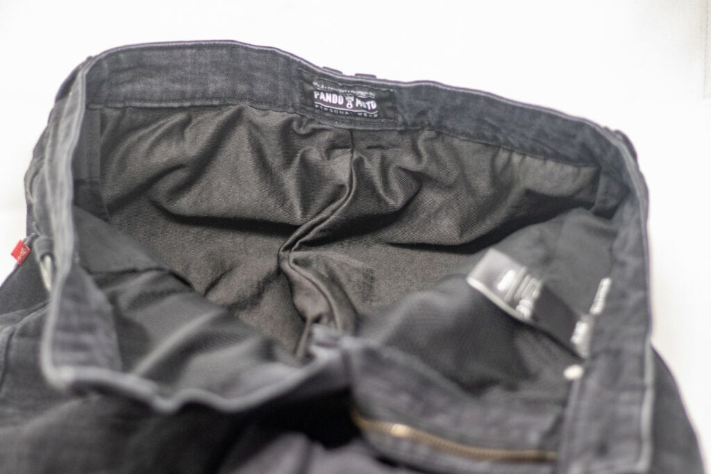 UHMWPE liner inside waist of jeans