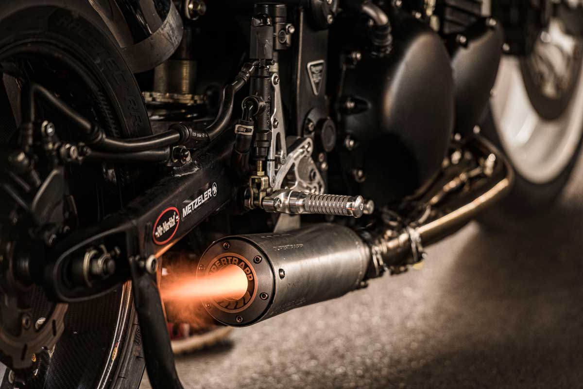 Custom motorcycle exhaust blowing a flame